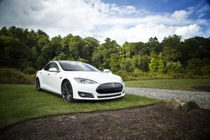Tesla Car in an open field
