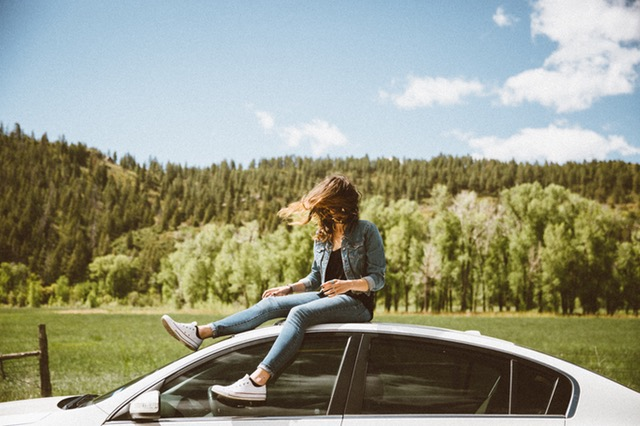 AA Auto Care woman relaxing on a car